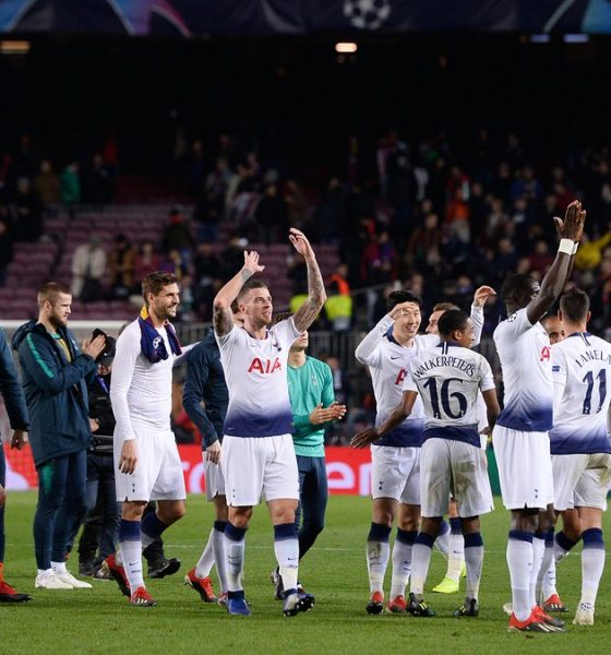 Tottenham players celebrate draw against Barcelona