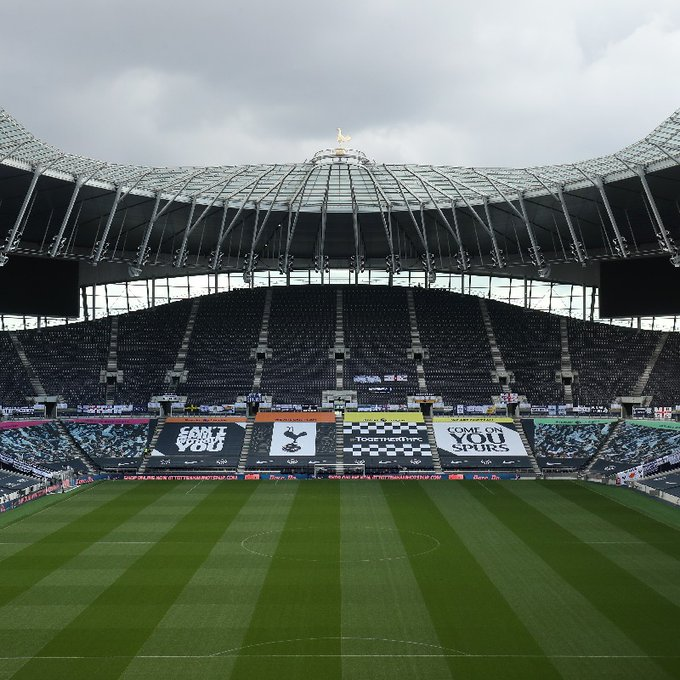 Tottenham Stadium with fan-made flags and banners
