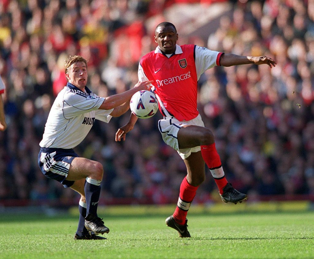Vieira in action against Spurs during his Arsenal days